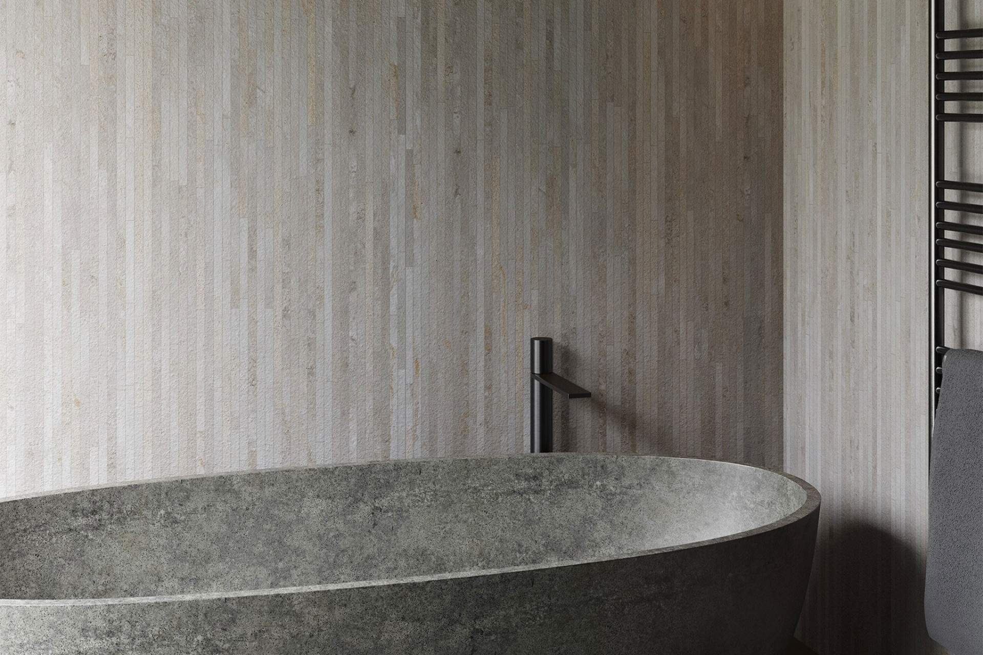 Fusion bathroom wall setting using grey bush hammered deco tile
