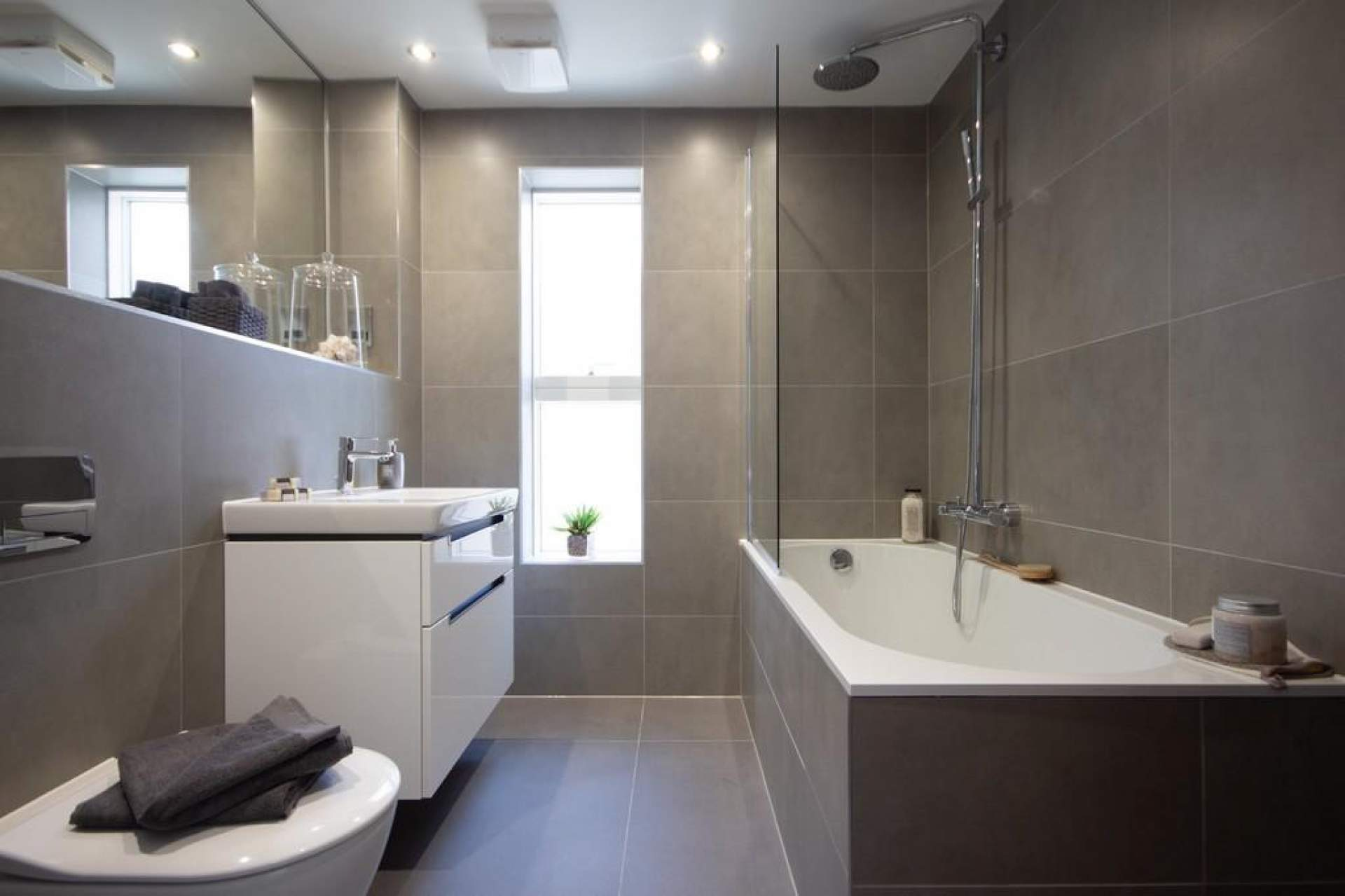 Micro Cement bathroom setting using Grey Tile