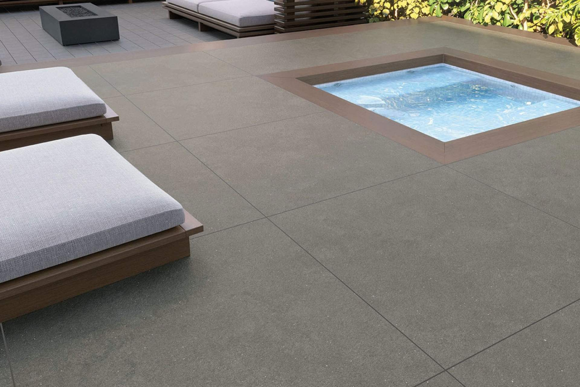 Surface patio setting using grey bush hammered tile