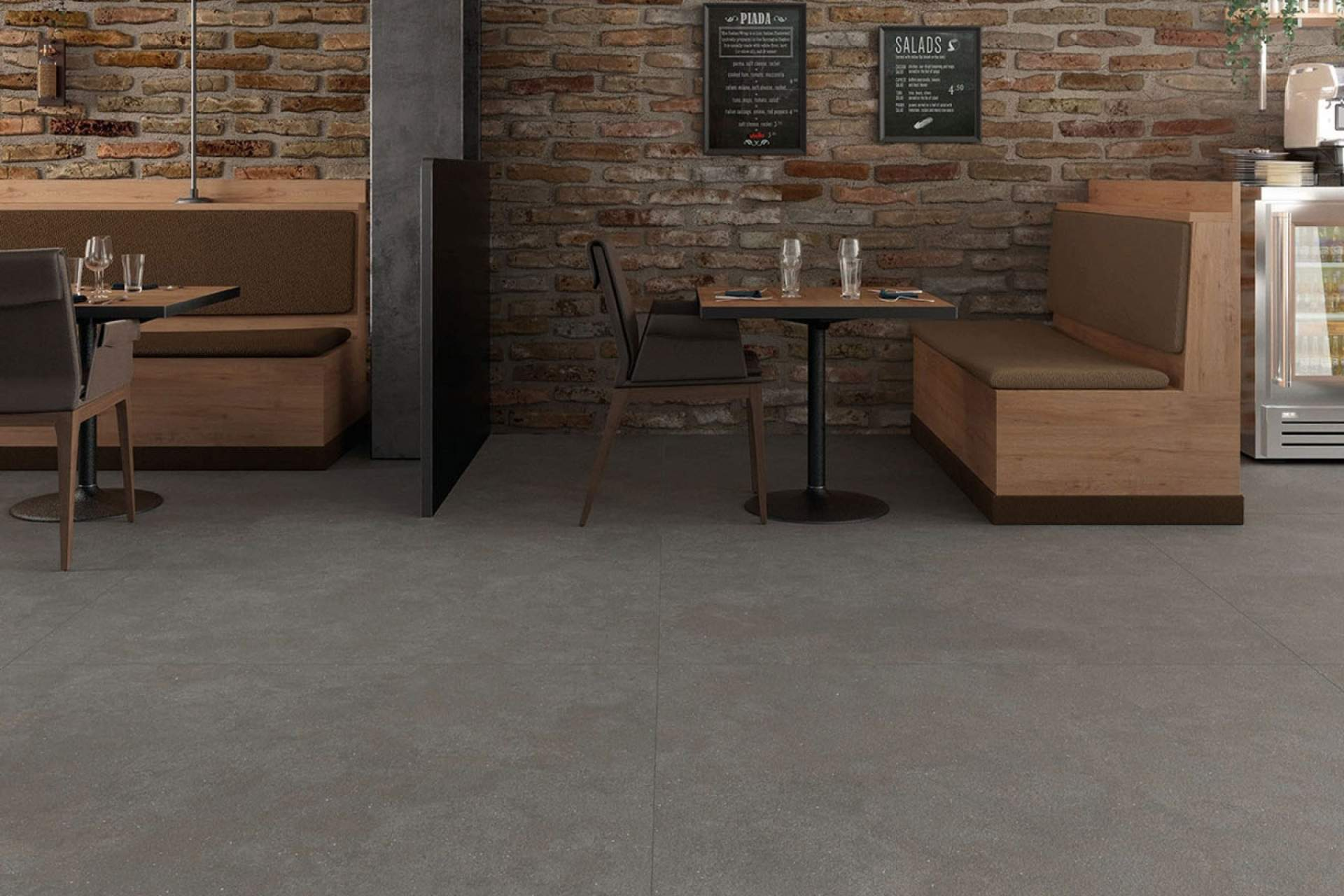 Surface restaurant setting using grey bush hammered tile