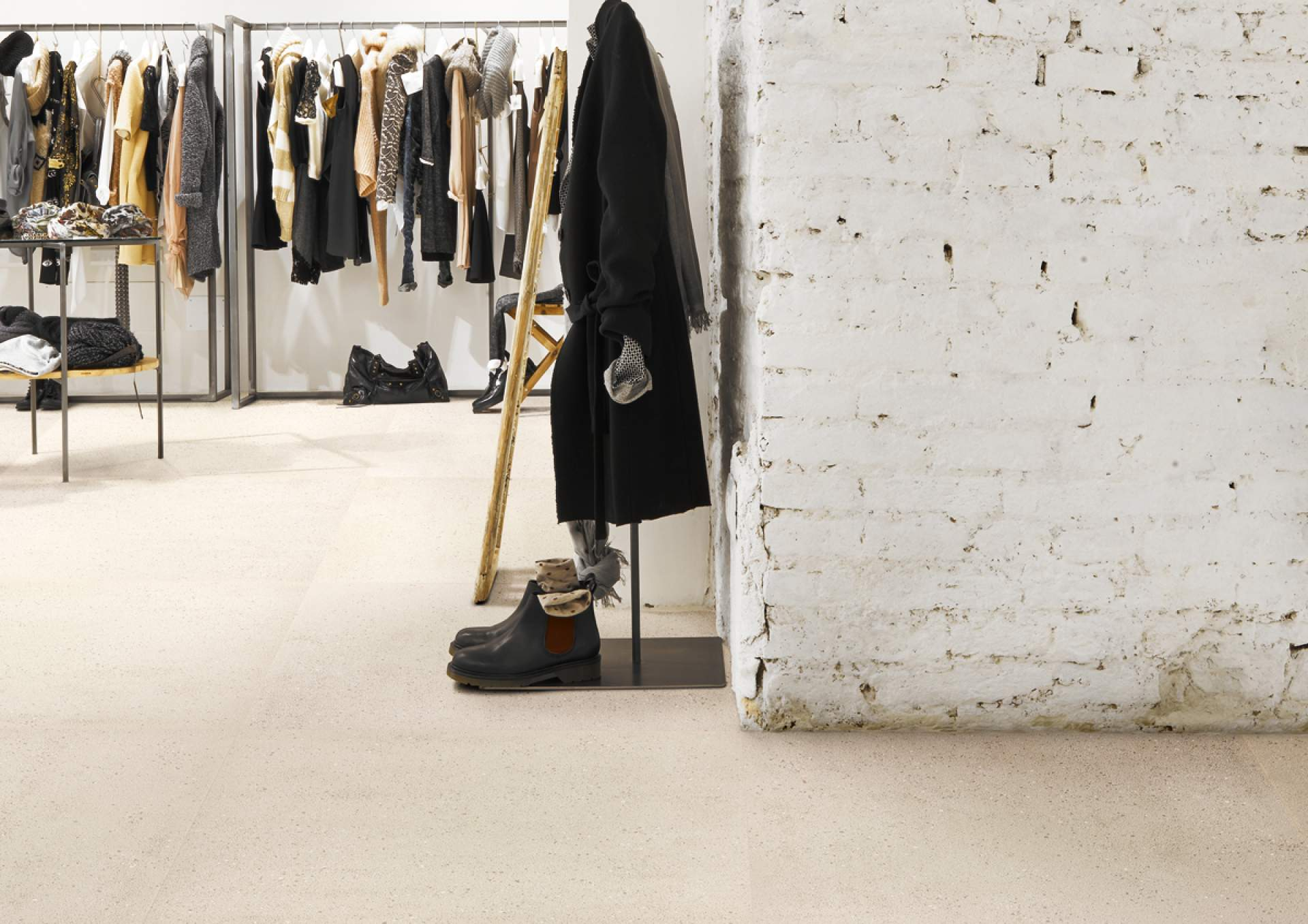 Technical Concrete shop setting with Beige Tile